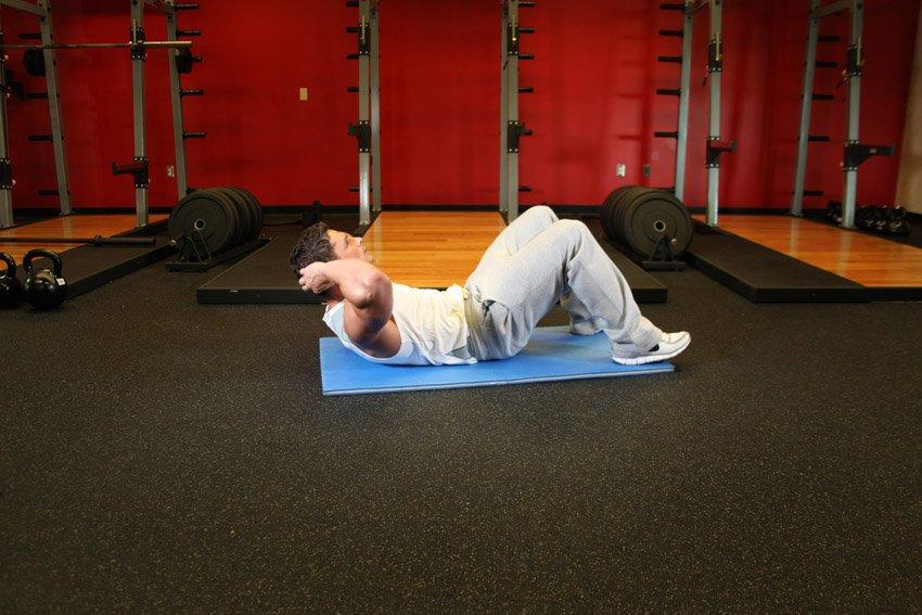 Скручивания лежа на полу