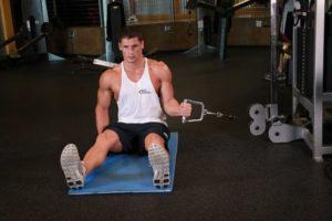 Внутреннее вращение плеча сидя
